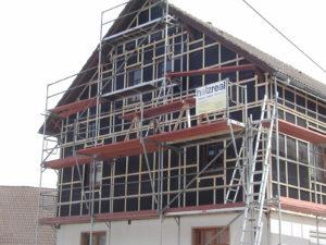 Erneuerung Fassade mit Zusatzdämmung aus Holzfaser und Winddichtungsfolie außen